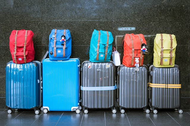 Suitcases packed for holiday travel I ABG Capital Blog
